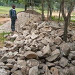 The Water Project: Ivakale Primary School & Community - Rain Tank 2 -  Field Officer Erick Wagacka Inspecting Locally Availed Materials