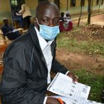 The Water Project: Ivakale Primary School & Community - Rain Tank 2 -  Village Administrator Mr Jethro Anami At Training