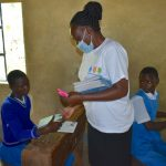 The Water Project: Ivakale Primary School & Community - Rain Tank 2 -  Trainer Mary Issues Training Materials To Pupils