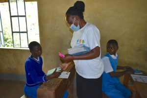 The Water Project:  Trainer Mary Issues Training Materials To Pupils