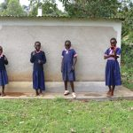 The Water Project: Kapkoi Primary School -  Girls Celebrate Next To Their Latrines