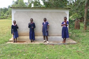 The Water Project:  Girls Celebrate Next To Their Latrines