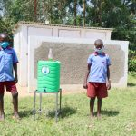 The Water Project: Mukoko Baptist Primary School -  Boys Posing With Their New Latrines And Handwashing Station