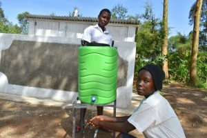 The Water Project:  Girls Handwashing Outside Of Their Latrines