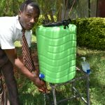 The Water Project: Friends Kisasi Secondary School -  Student Washing Hands