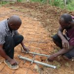 The Water Project: Friends Kisasi Secondary School -  Setting Drawing Point Pipes