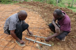 The Water Project:  Setting Drawing Point Pipes