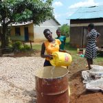 The Water Project: Ivakale Primary School & Community - Rain Tank 2 -  Students Deliver Water For Construction
