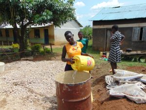 The Water Project:  Students Deliver Water For Construction