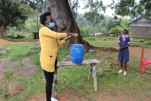 The Water Project:  Trainer Olivia Demonstrates Ten Steps Of Handwashing