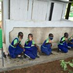 The Water Project: Boyani Primary School -  Girls Pose With Their Latrines