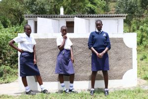 The Water Project:  Girls In Front Of Their New Latrines