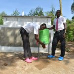 The Water Project: Kinu Friends Secondary School -  Boys Handwashing Outside Their Latrines