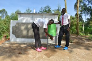 The Water Project:  Boys Handwashing Outside Their Latrines