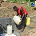 The Water Project: Maraba Community, Nambwaya Spring -  Rinsing And Fetching At The Same Time