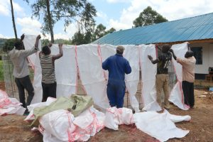The Water Project:  Wrapping Sugarsacks To Tank Frame