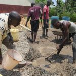 The Water Project: Friends Kisasi Secondary School -  Community Members Mix Concrete