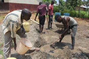 The Water Project:  Community Members Mix Concrete