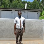 The Water Project: Friends Kisasi Secondary School -  Student Poses At The Latrines