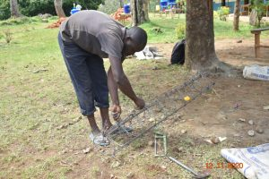 The Water Project:  Preparing Wire For Use