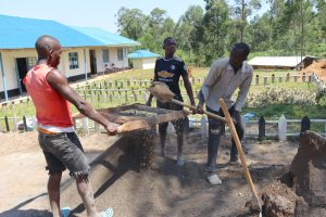 The Water Project:  Sieving Sand For Plastering