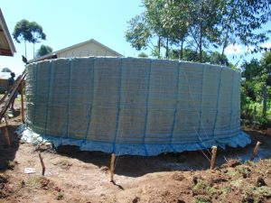 The Water Project:  Sugar Sacks On Tank Skeleton Wall