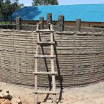 The Water Project: Kinu Friends Secondary School -  First Layer Of Cement