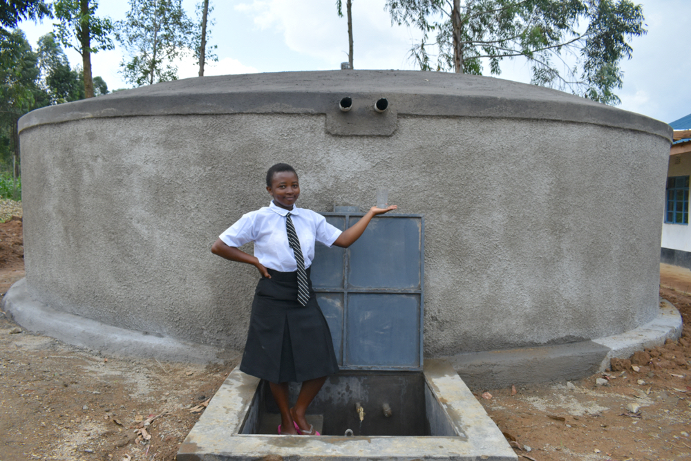 The Water Project : 7-kenya20130-edith-holds-a-glass-of-water-from-the-tank