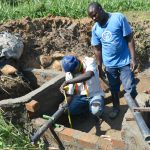 The Water Project: Shitavita Community, Patrick Burudi Spring -  Fixing Discharge Pipes