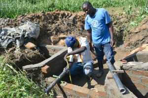 The Water Project:  Fixing Discharge Pipes