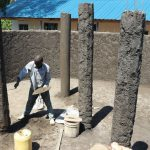 The Water Project: Kinu Friends Secondary School -  Platering The Pillars