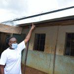 The Water Project: Ivakale Primary School & Community - Rain Tank 2 -  Trainer Mary Afandi Explaining Gutter Maintenance