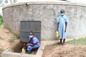 The Water Project:  Collecting Water At The Tank