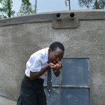 The Water Project: Kinu Friends Secondary School -  Taking A Sip Of Water
