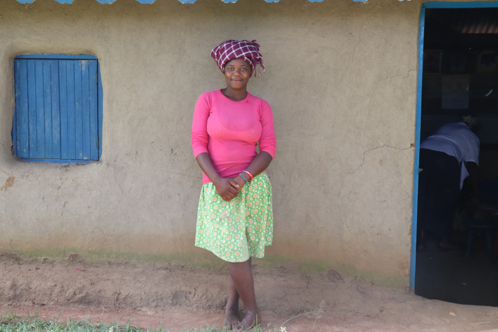 The Water Project : covid19-kenya18126-rose-nasenya-outside-her-house