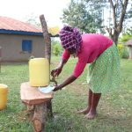 The Water Project: Luyeshe Community, Matolo Spring -  Rose Washes Her Hands