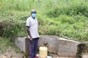 The Water Project:  John Fetching Water