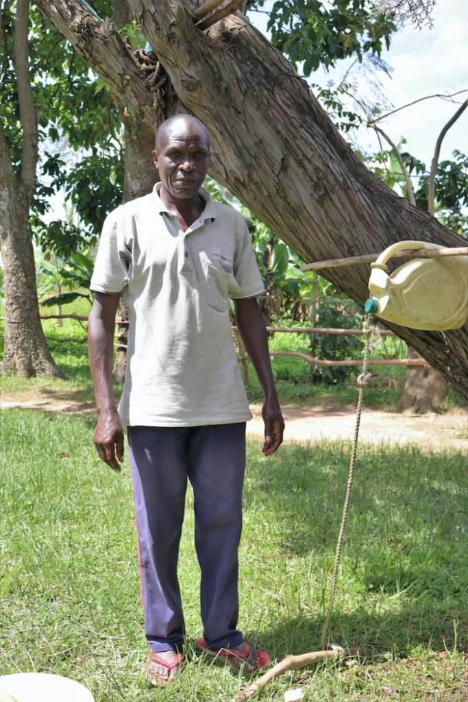 The Water Project : covid19-kenya18150-next-to-the-tippy-tap-handwashing-station