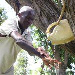 The Water Project: Futsi Fuvili Community, Simeon Shimaka Spring -  Washing His Hands
