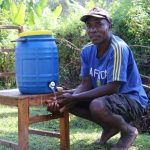 The Water Project: Rosterman Community, Kidiga Spring -  David Washing His Hands