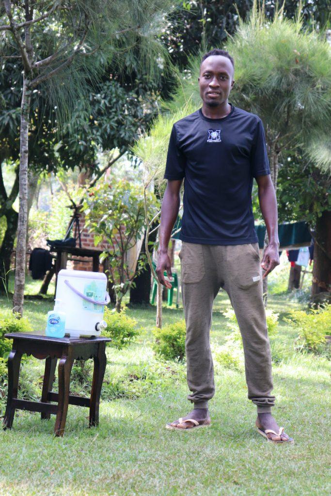 The Water Project : covid19-kenya19139-emmanuel-lishenga-next-to-the-handwashing-station