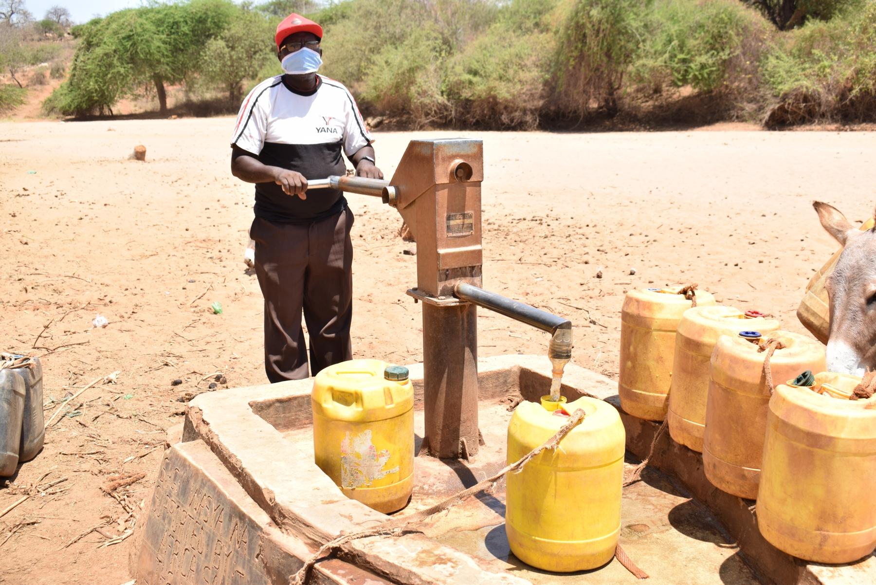 The Water Project : covid19-kenya4498-leonard-nguluma-maloloi-fetching-water-2