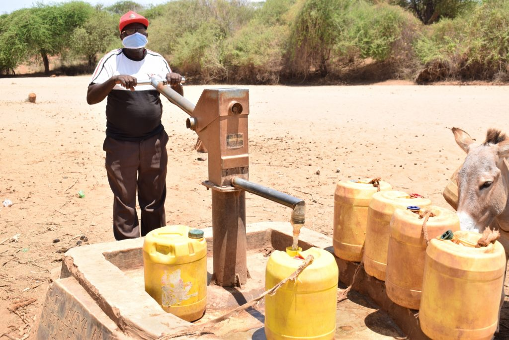 The Water Project : covid19-kenya4498-leonard-nguluma-maloloi-fetching-water-3