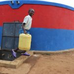 The Water Project: Ivakale Primary School & Community - Rain Tank 2 -  Brian Carries Water From The Tank