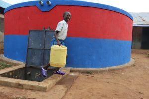 The Water Project:  Brian Carries Water From The Tank