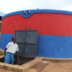 The Water Project: Ivakale Primary School & Community - Rain Tank 2 -  Brian Fetching Water