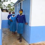 The Water Project: Ivakale Primary School & Community - Rain Tank 2 -  Girls Posing At Their Latrines