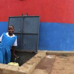 The Water Project: Ivakale Primary School & Community - Rain Tank 2 -  Metrine Collecting Water