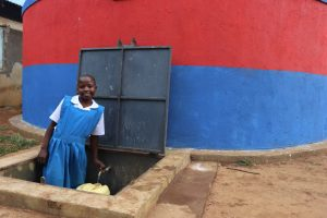 The Water Project:  Metrine Collecting Water