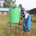 The Water Project: Ivakale Primary School & Community - Rain Tank 2 -  Metrine Washes Her Hands